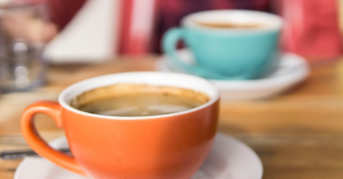 Two cups of coffee - one orange, one turquoise