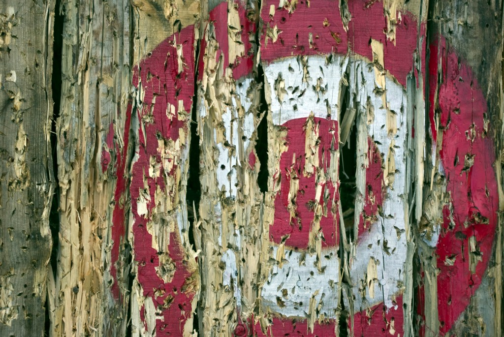 rustic red target on wooden wall worn off