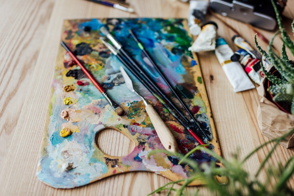 Messy paint palette in artist's studio