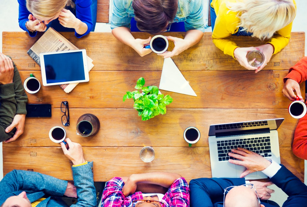 Overhead of people talking about business in a cafe