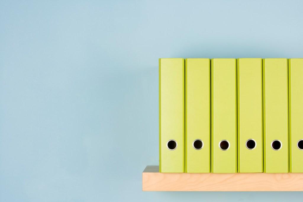 Lime green binders on shelf