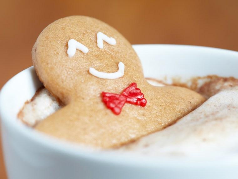 Gingerbread man relaxing in coffee