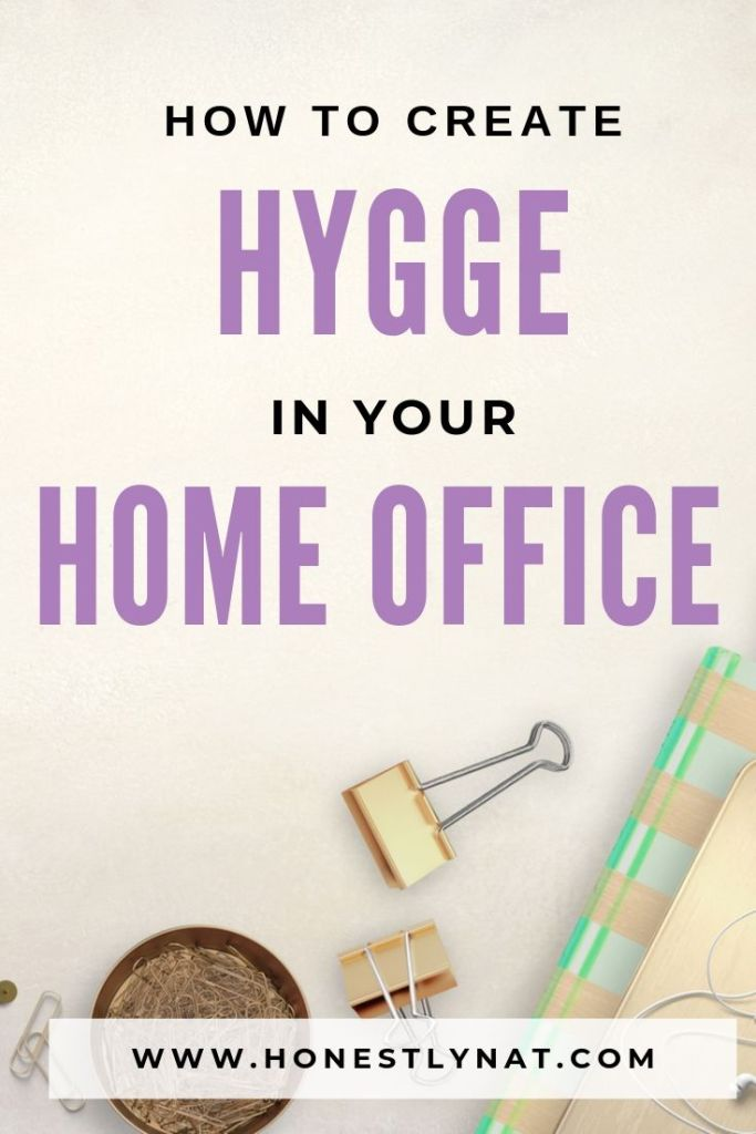 "Desk flat lay with pretty notebook and the text overlay ""How to create hygge in your home office"""