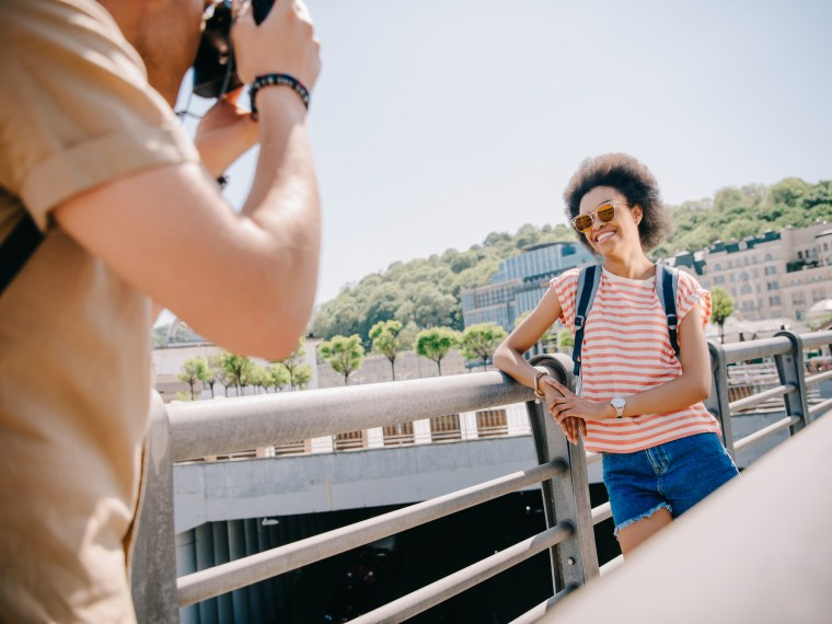 Photographer taking profile picture of woman