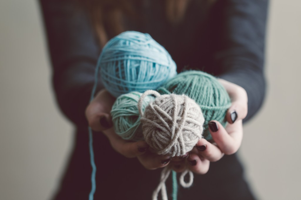 Woman holding balls of yarn