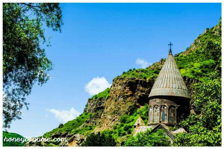 Geghard Monastery against the backdrop of nature and mountain rocks