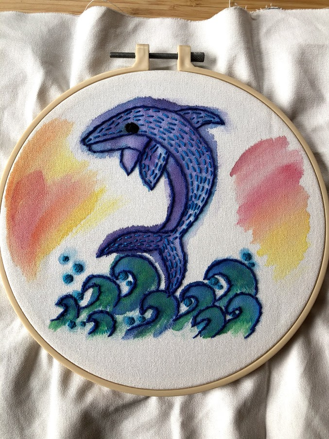 a dolphin jumping over waves, painted in messy watercolor and embroidered on the outlines