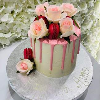 Pink Rose Drip Cake with macarons and flowers