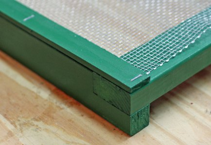 I stapled the hardware cloth in place and then stapled the wooden strips on top.