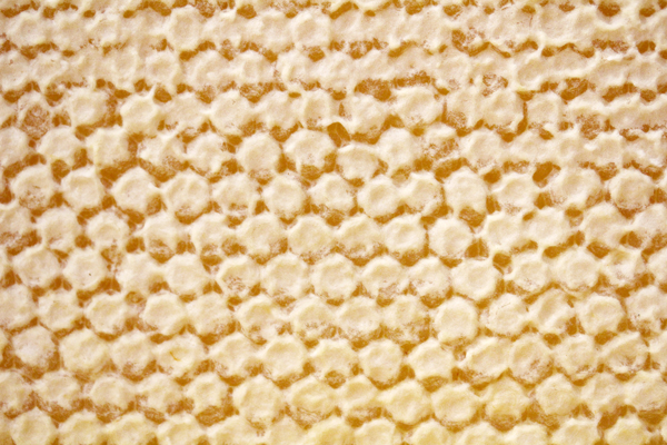 Dry cappings are preferred by consumers. The dry appearance is caused by a small pocket of air just below the cappings. Cappings that appear wet lack an air pocket.