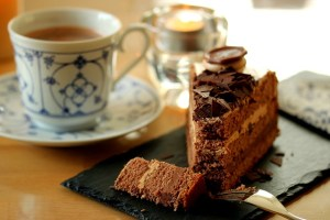 Many recipes lead to chocolate cake. Photo of cake and coffee.