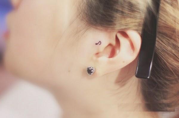 small music tattoo on ear