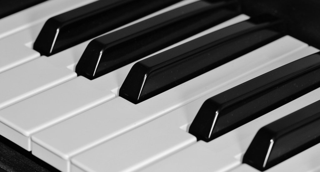 image of keys of a piano for relaxing music. It takes a few minutes to relax with calming music