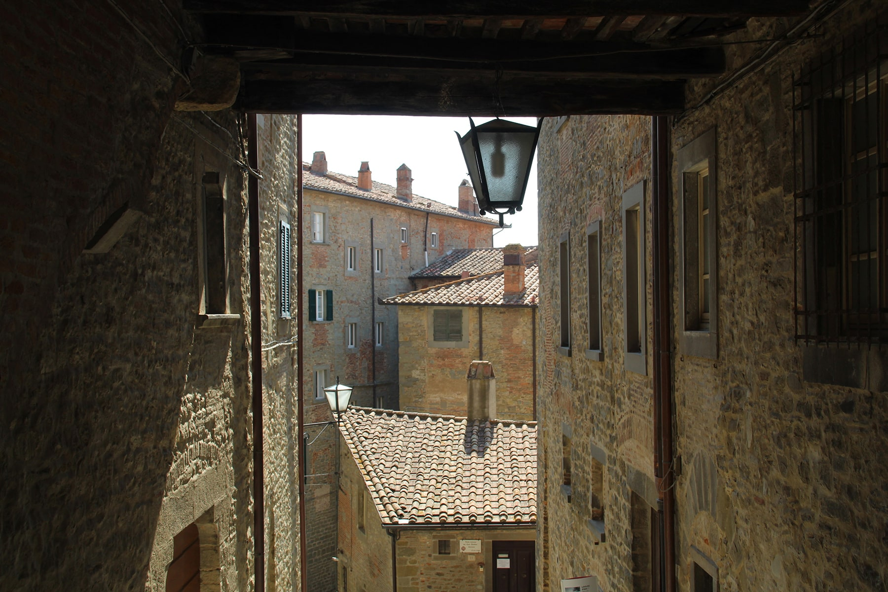 View on rooftops of Perugia from an arch