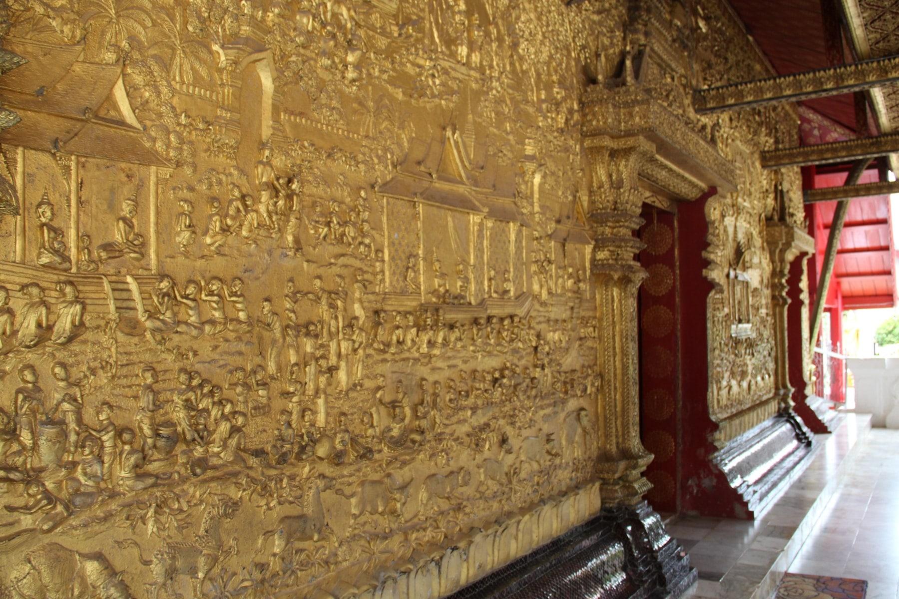Golden walls of Wat Mai Suwannaphumaham Luang Prabang