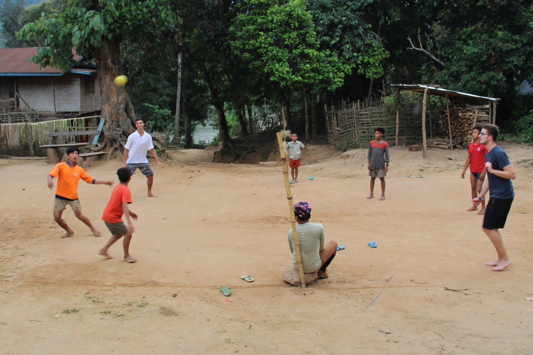 Kids playing ball with homestay guests