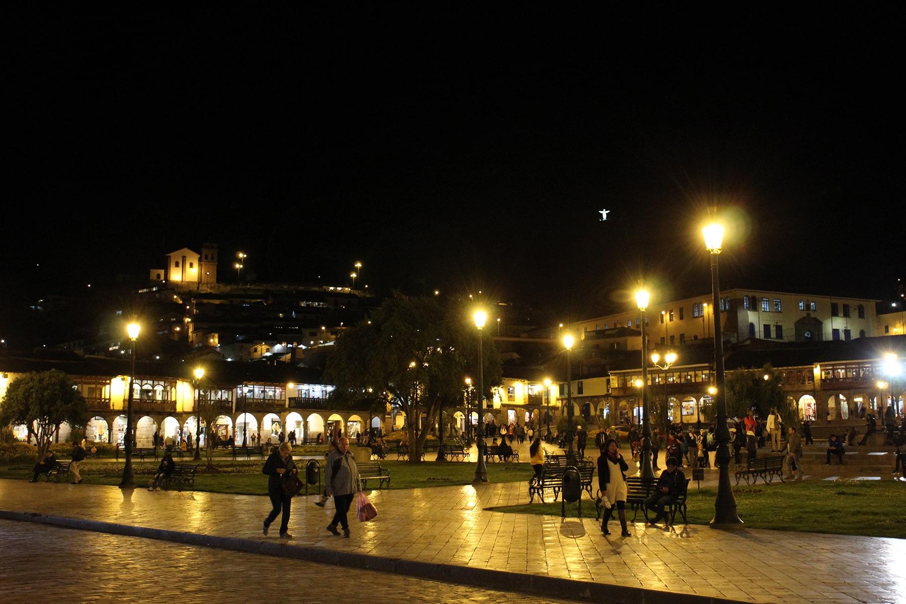 Cuzco plaza de armas at night with Christ statue