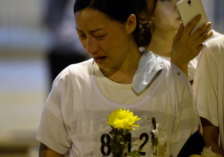 tianjin explosion blast mourner