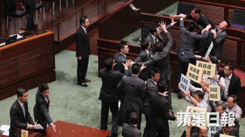 Raymond Wong threw cup at Leung Chun-ying.