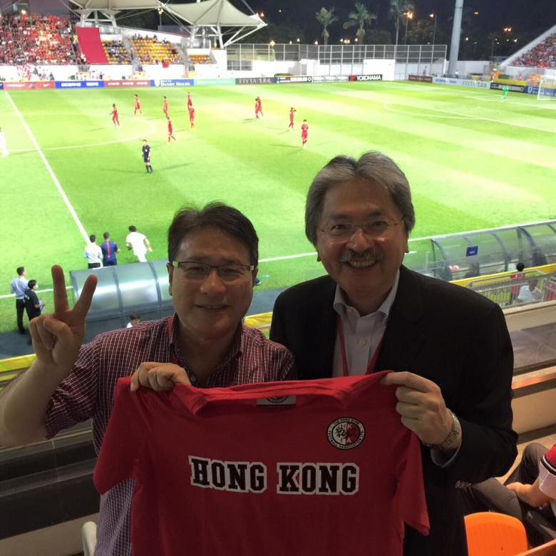 John Tsang posed with a Hong Kong team jersey in Mong Kok Stadium.