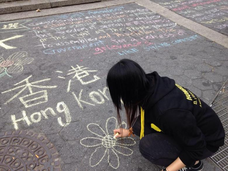 People drew symbols of the Occupy protest.