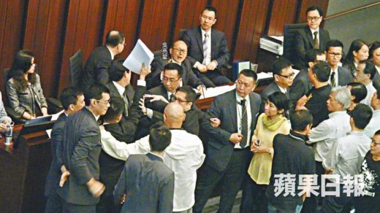 Ng Leung-sing was surrounded by lawmakers to protest against him at a Finance Committee meeting in June 2014.