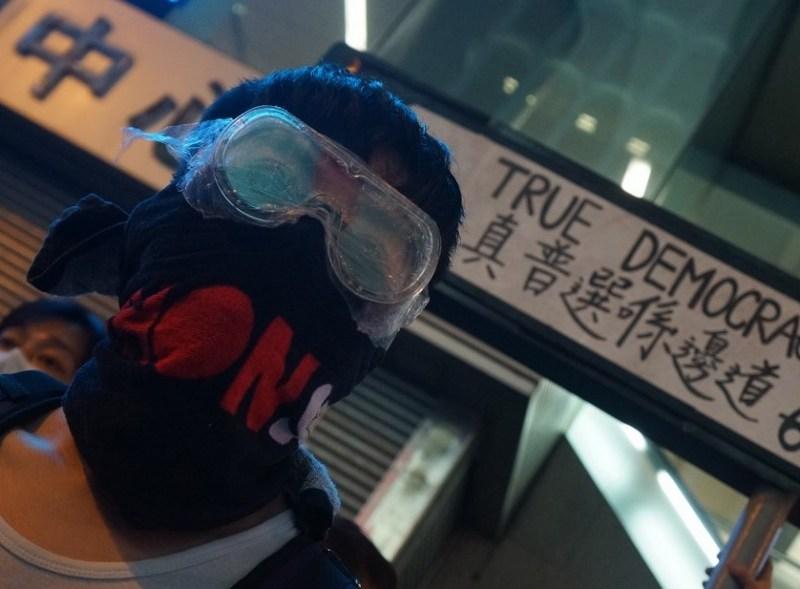 occupy protester umbrella protester