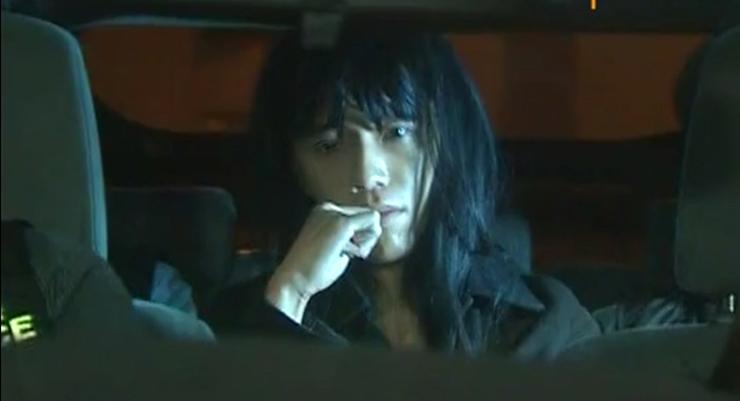 Nakade Hitsujiko in a police car.