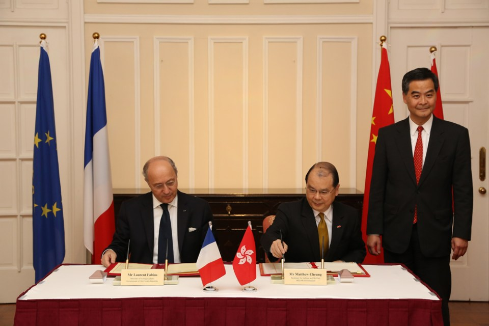 The signing of the agreement in May 2013.