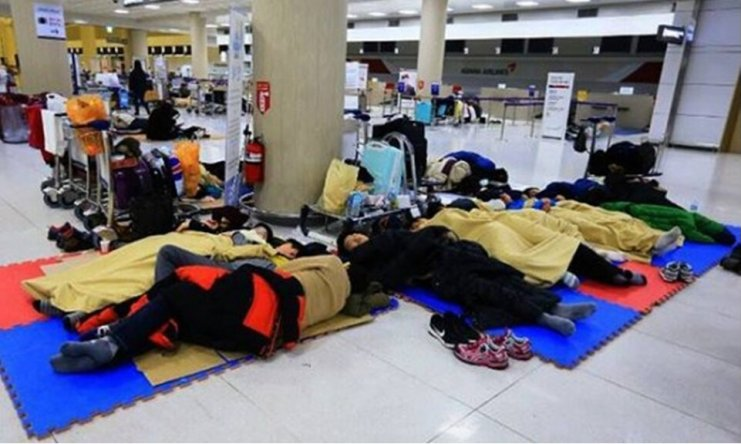 People sleeping in Jeju Airport