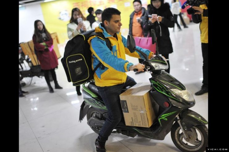 Delivery worker on a moped