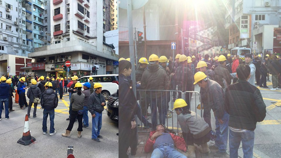 Around 50 construction workers have occupied a road in Fortress Hill in protest over unpaid wages.