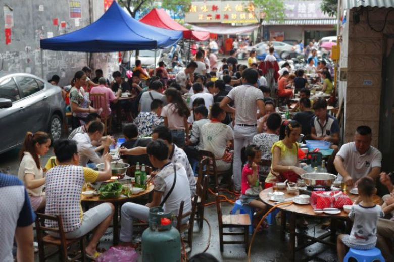 People eating at Yulin Dog Meat Festival