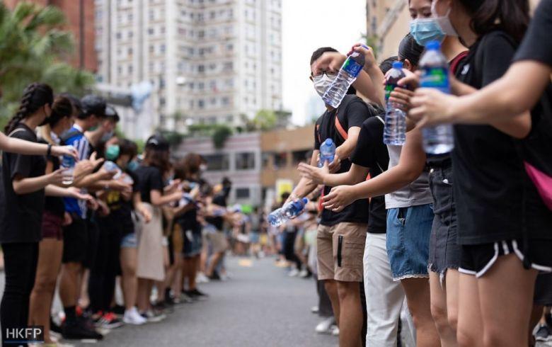 human chain hand action sha tin july 14 china extradition (1)