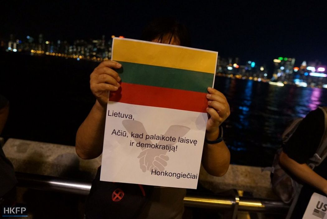 "A demonstrator in his 60s, who prefers to stay anonymous because of business in mainland China, held a poster in Lithuanian. He said he went to protests whenever he has time. ""I studied the whole story [of the Baltic Chain] before coming. During the last protest at Victoria Park, we have already thought about the idea, and we want to make the chain happen,"" he said. ""We want to show we are peaceful and united. We have different views during the movement, but we have a common goal."""