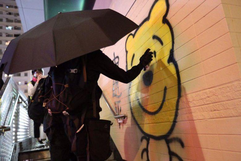 """December 1"" Xi Jinping cockroach Winnie the Pooh graffiti spray paint protester umbrella Kowloon"