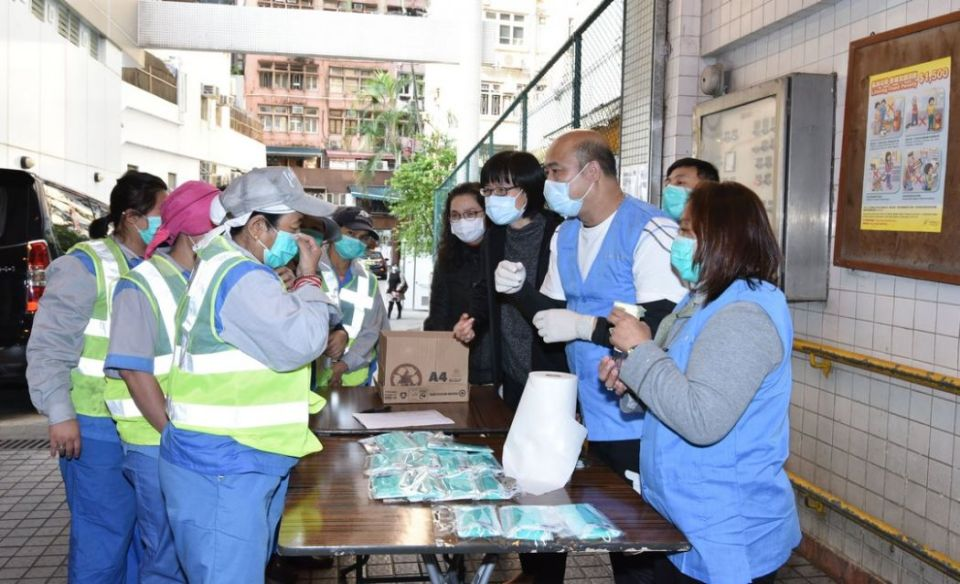 Street cleaners face mask distribution