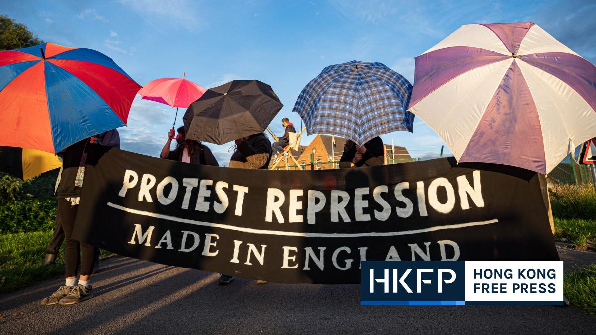 extinction rebellion umbrella protest