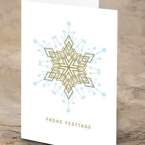Die Karte für ihr Weihnachtsgeschenk in gold/blau mit Weihnachtsstern