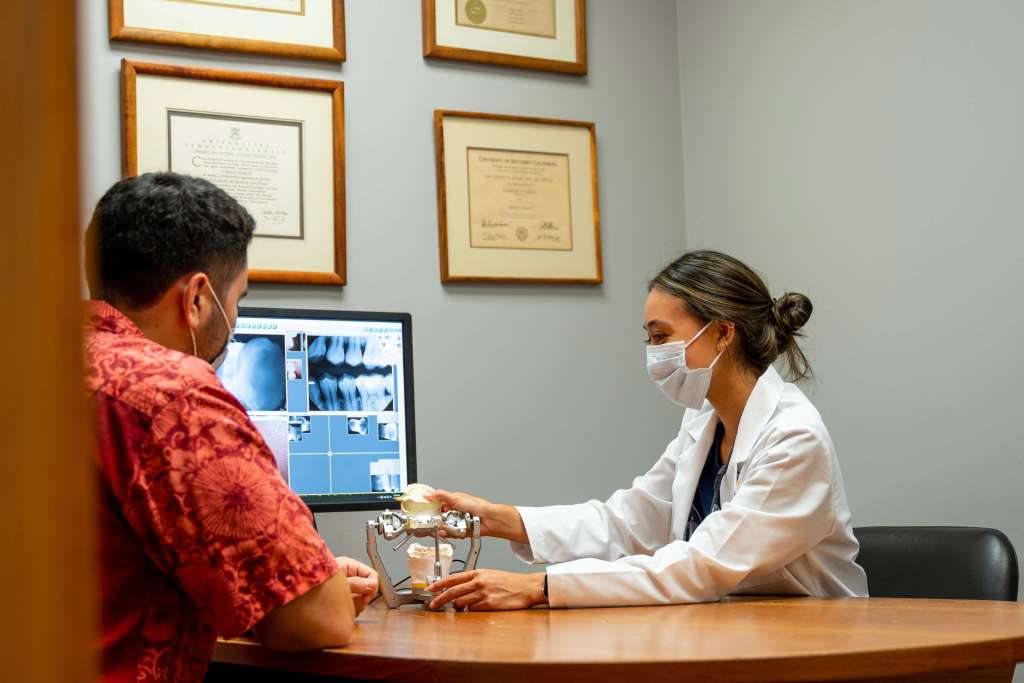 Honolulu dentist, Dr. Adachi, discussing treatment plan with patient