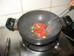 Oil, garlic, tomato and cilantro for the dal