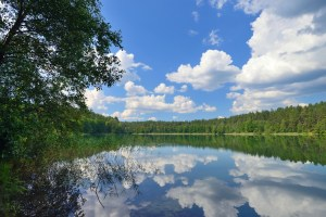 A tranquil lake reflecting the sky