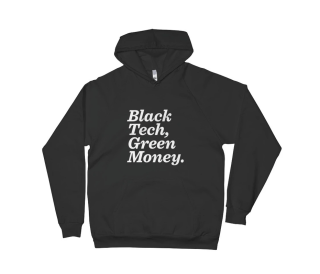 "A hooded sweatshirt sold at AfroTech. Black with text that reads: ""Black Tech, Green Money."""