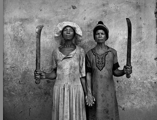 Two African women holding hands.