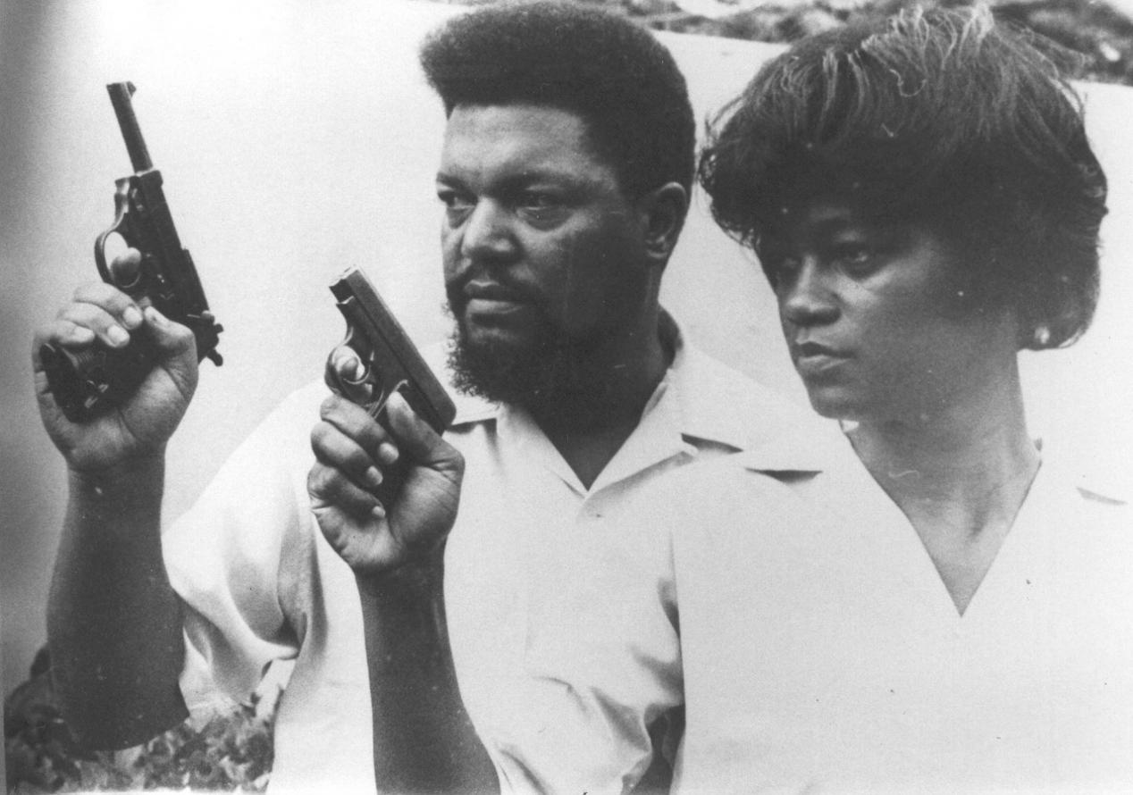 Civil Rights Activist Robert F Williams and his wife, Mabel Ola Robinson, training with guns gifted to them by Fidel Castro. 1962.