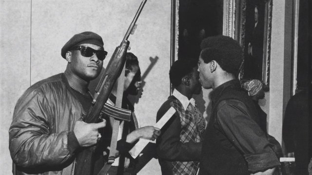 Members of the Black Panther Party armed with guns