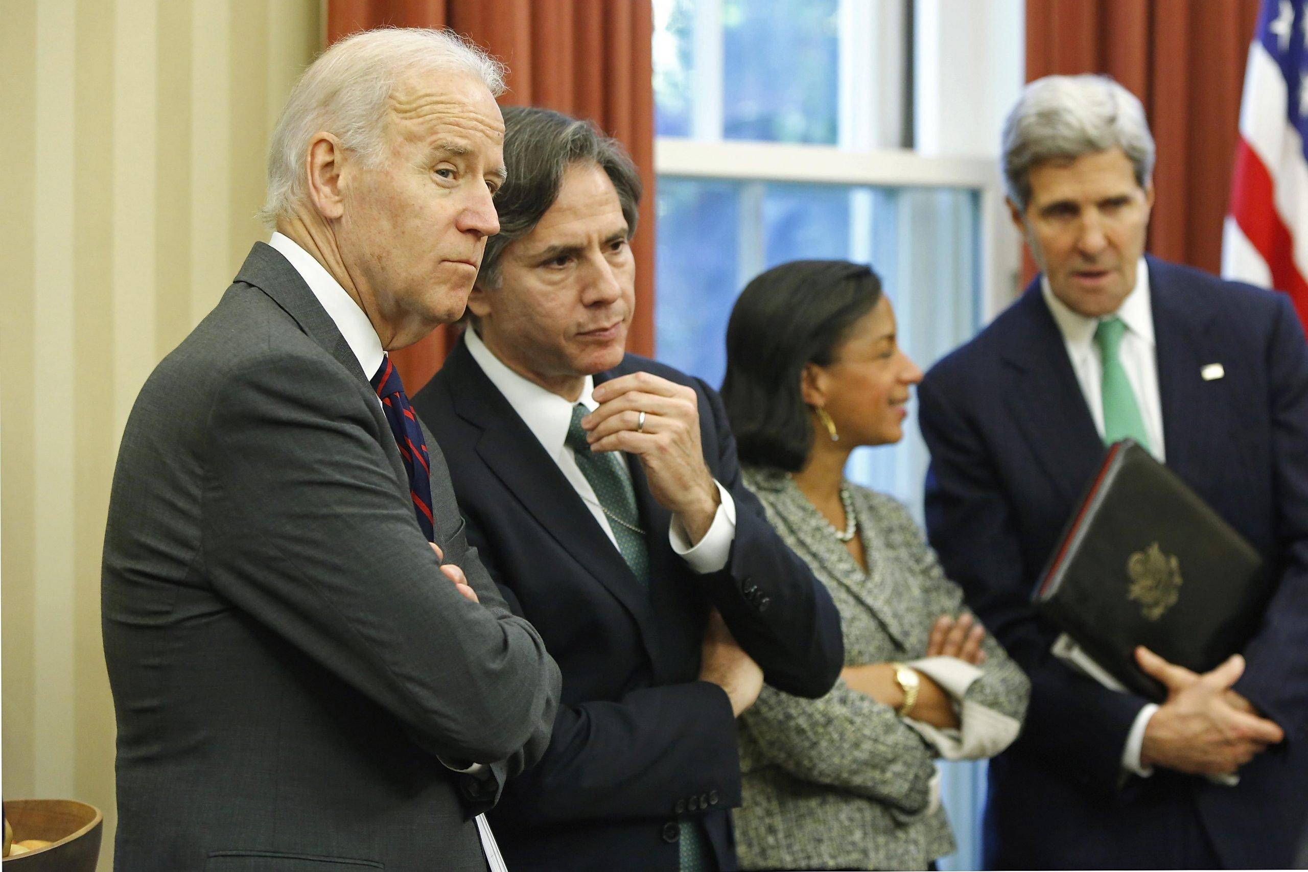 US president Joe Biden, Secretary of State Antony Blinken, Domestic policy czar Susan Rice, and John Kerry in the white house's Oval Office.