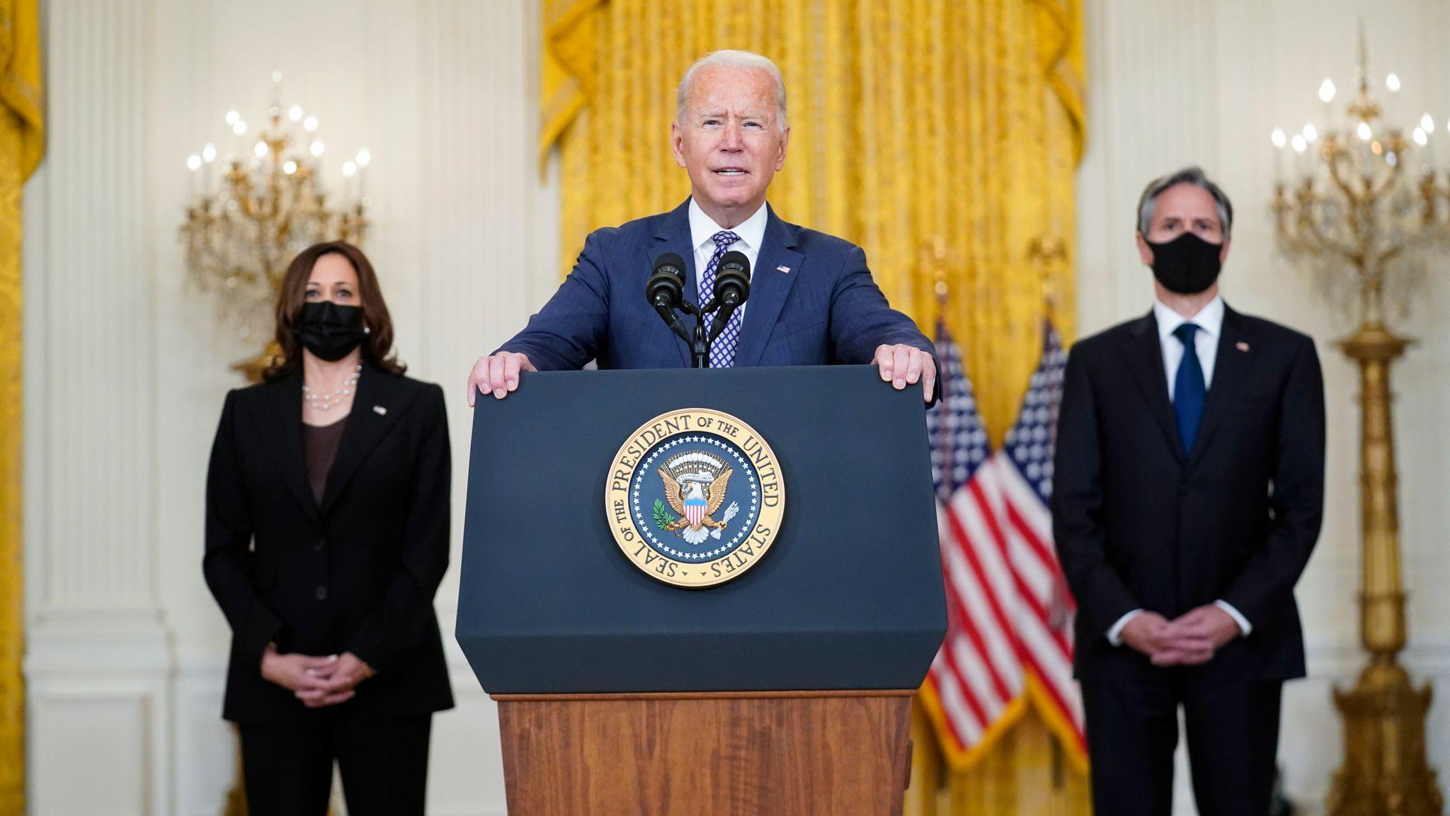Kamala Harris and Antony Blinken flank Joe Biden as he gives remarks about US imperialism in Afghanistan