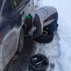 Changing the tire.