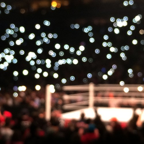Blurred lights as Bray Wyatt comes out.